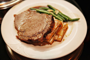 Slow Roasted Prime Rib of Beef with Herbed Au Jus served with Potato ...